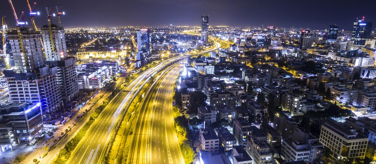 Night Aerial View Of Tel Aviv Skyline With Urban Skyscrapers And